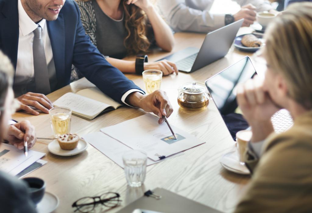organization members talking in a table